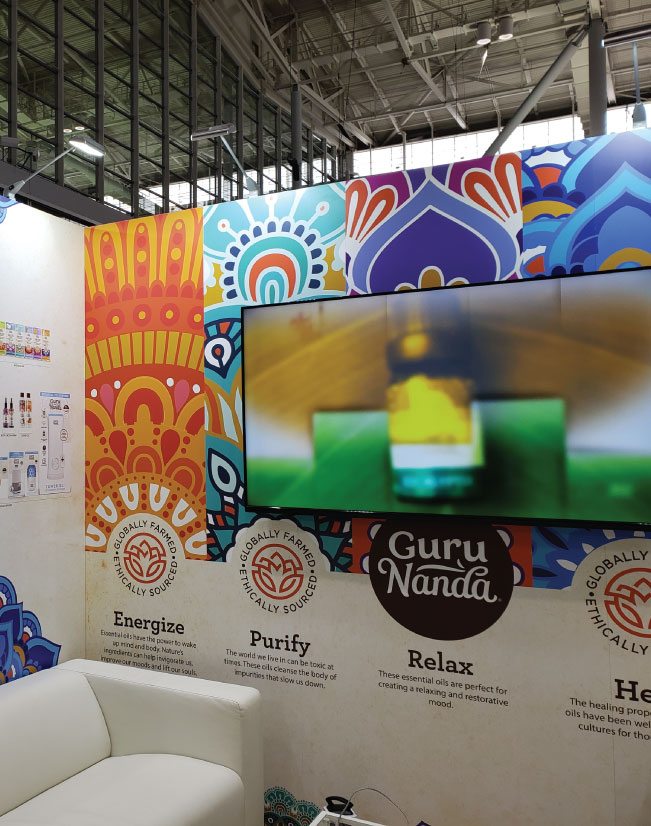 an interior image of the Guru Nanda activation, showing the media player and seamless sintra backwall