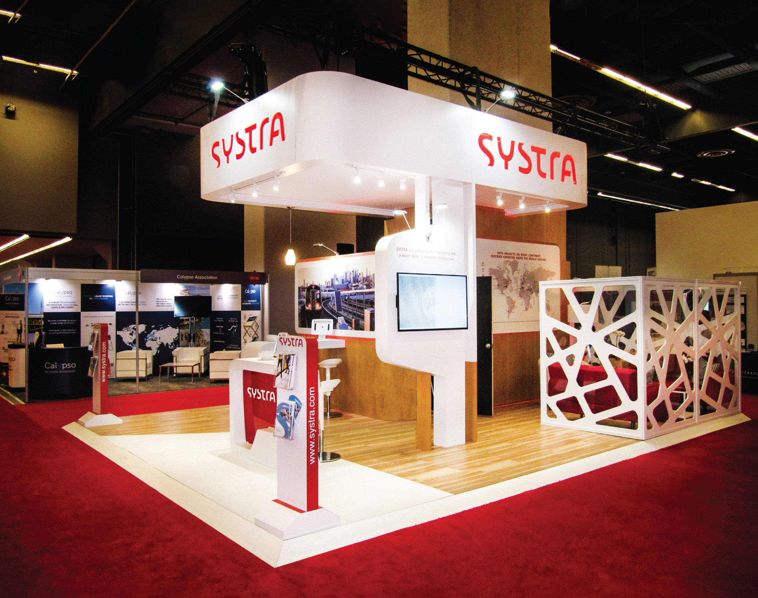 an image of the Systra activation, with a custom desk and fabricated wall