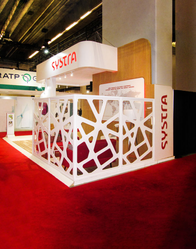This is a corner view of the Systra activation, with the seating area and geometric wall