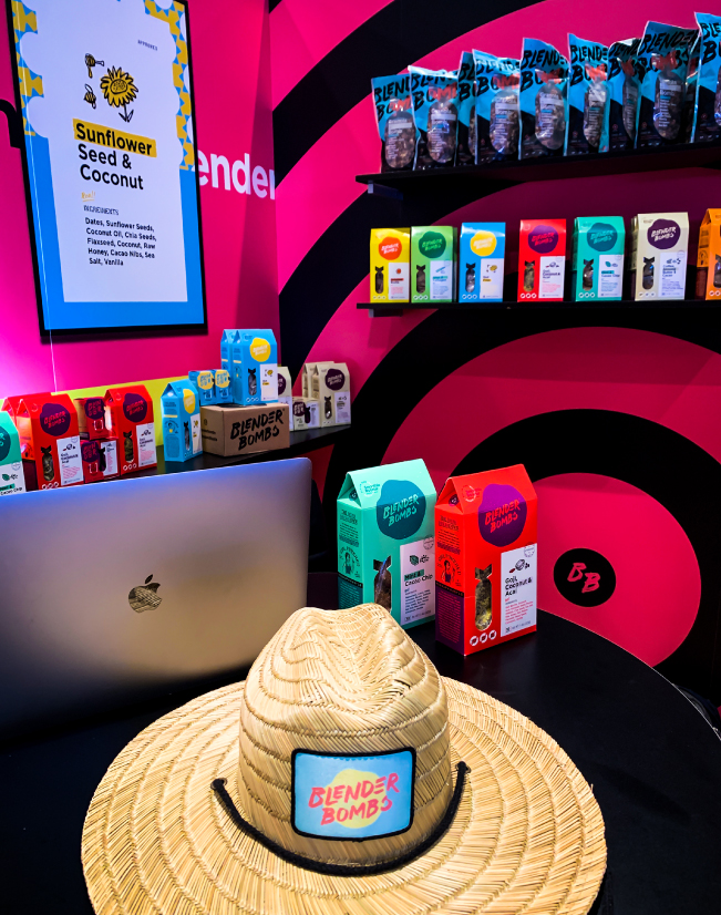 an interior image of the Blender Bombs activation, with the desk visible