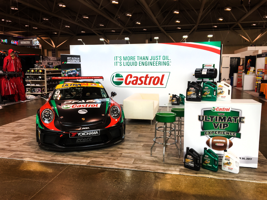 an image of the Porsche car at the Castrol activation, with the seamless sintra counter