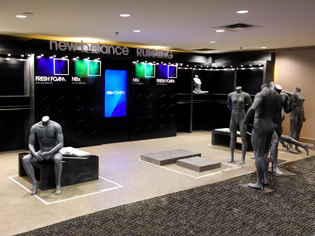 an image of the New Balance showroom, with the media player visible
