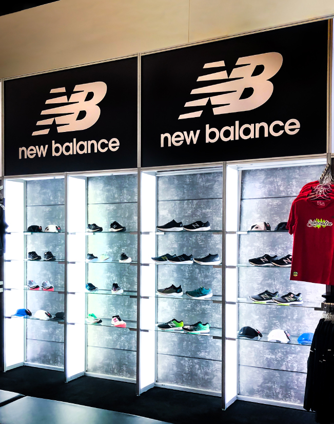 an image of the New Balance shelving unit, with clear glass